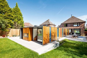 Radical-Extensions-long-single-storey-extension-wood-clad-and-coloured-panels